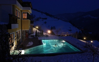 open-air pool by night